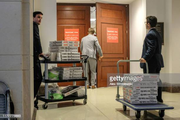 Staffers deliver pizza to a closed session before the House Intelligence Foreign Affairs and Oversight committees on Capitol Hill on October 23 2019...