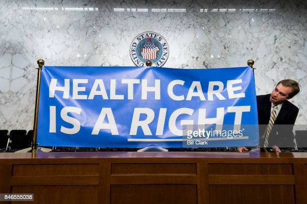 Staffers set up signs for Sen Bernie Sanders' event to introduce the Medicare for All Act of 2017 on Wednesday Sept 13 2017
