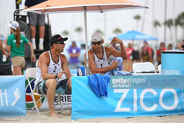 Stafford Slick and Casey Jennings of USA discuss game plan during a break in play during the men's pool play round at the ASICS World Series of Beach...