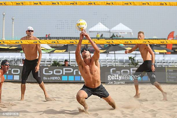 Stafford Slick lunges for the ball as Jake Gibb and Casey Patterson prepare to return at the AVP Beach Volleyball Manhattan Beach on July 16 2016 in...