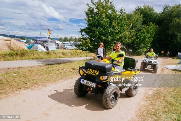 ADAC staffs are seen at the camping village at the 'Nature One' massive rave held at the former US rocket base Pydna on August 5 2017 in Kastellaun...
