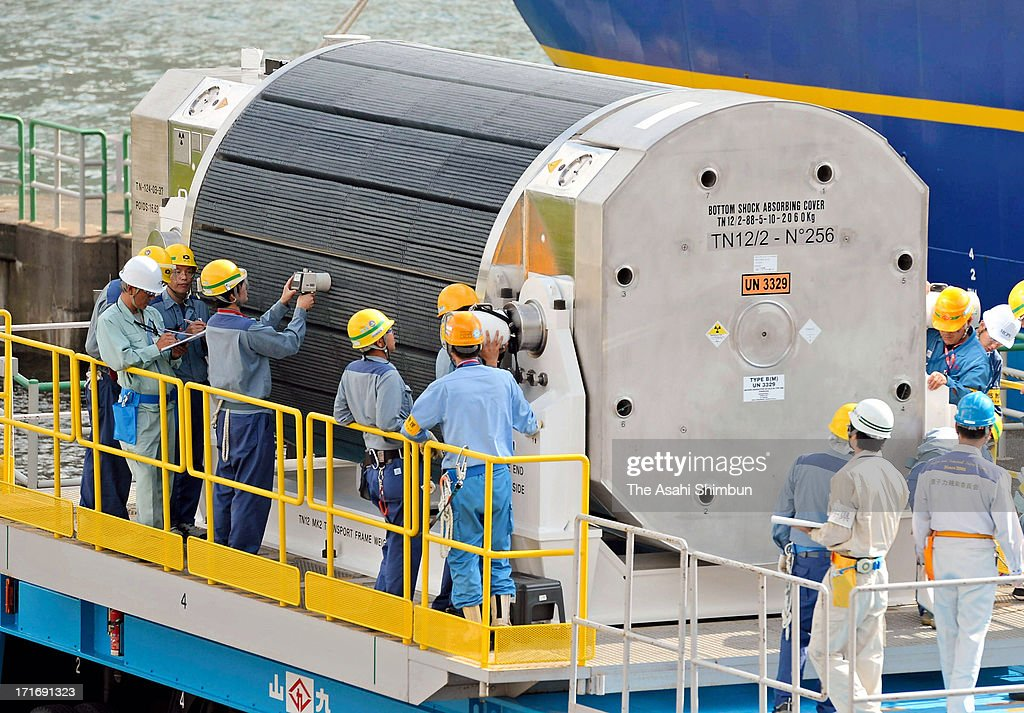 Staffs check mixed oxide (MOX) fuel unloaded from a freighter at Kansai Electric Power Co Takahama Nuclear Power Plant on June 27, 2013 in Takahama, Fukui, Japan. Protesters oppose outside the plant as this is the first shipment of MOX fuel since the meltdowns at the Fukushima No. 1 power plant arrived in Japan, which plutonium stockpile is already equivalent to 5,000 Nagasaki-type atomic bombs.