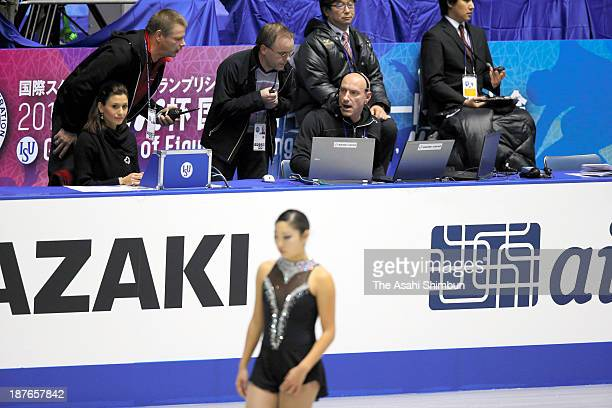 ISU staffs discuss as their scoring system is down during day two of the ISU Grand Prix of Figure Skating 2013/2014 NHK Trophy at Yoyogi National...
