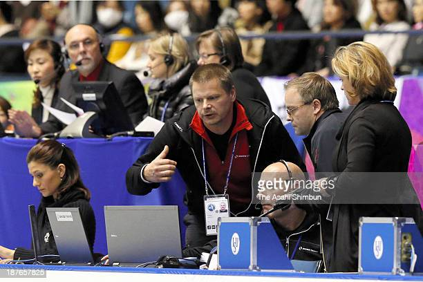 ISU staffs discuss as theri scoring system is down during day two of the ISU Grand Prix of Figure Skating 2013/2014 NHK Trophy at Yoyogi National...