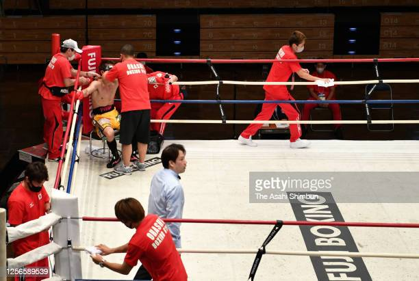 Staffs disinfect ropes every interval during the Japan Super Lightweight Title Bout between Hiroki Inoue and Daishi Nagata at Korakuen Hall on July...