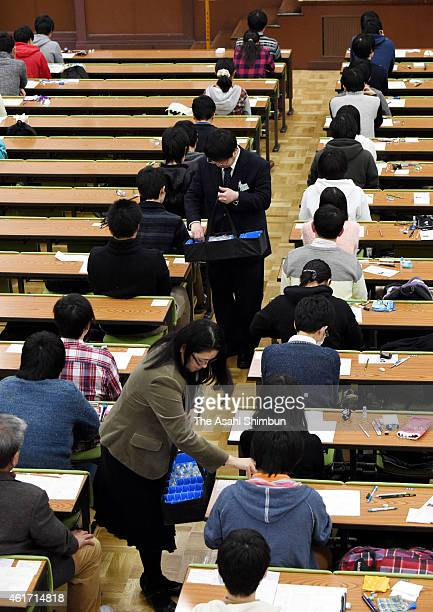 Staffs distrubute devices for the English listening during the national center exams at Tokyo University on January 17, 2015 in Tokyo, Japan. 559,132...