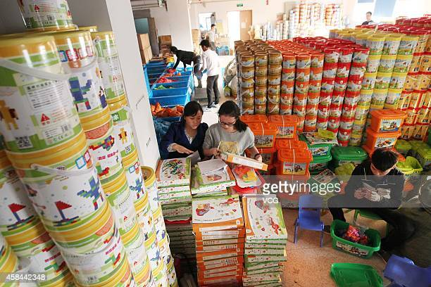 Staffs of an ecommerce store prepare goods for Singles' Day Discounts on November 5 2014 in Wenzhou Zhejiang province of China Online shopping...