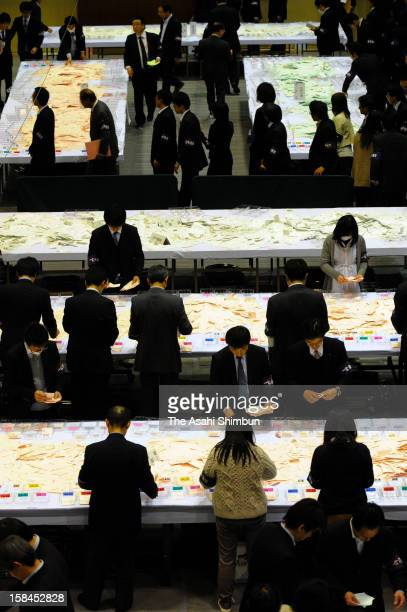 Staffs of Election Board counts at a ballot counting center on December 16 2012 in Ichinomiya Aichi Japan The Liberal Democratic Party and coalition...