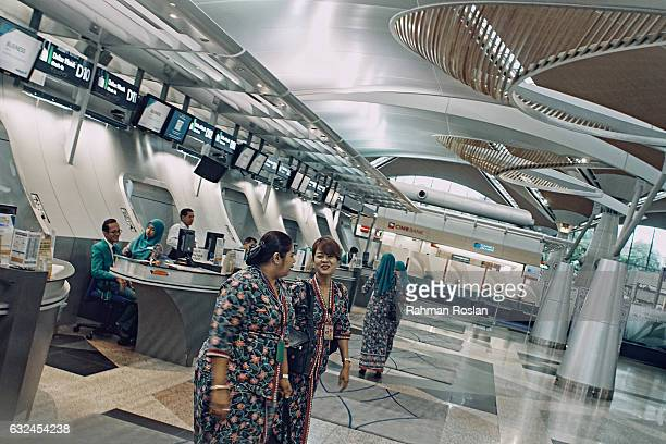 Staffs of Malaysian Airline is seen at the departure terminal of Kuala Lumpur International airport on January 23 2017 in Sepang Malaysia The...