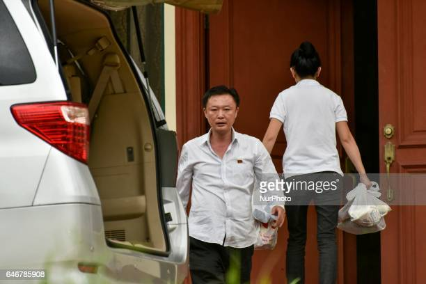 Staffs of North Korean embassy carry grocery bags and enter the embassy in Kuala Lumpur Malaysia on March 01 2017