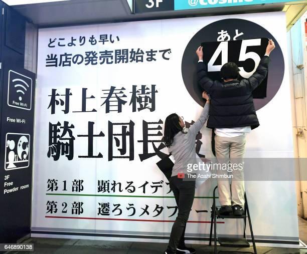 Staffs prepare to the launch of Haruki Murakami's 'Kishidancho Goroshi' a twovolume work prior to going on sale on February 23 2017 in Osaka Japan