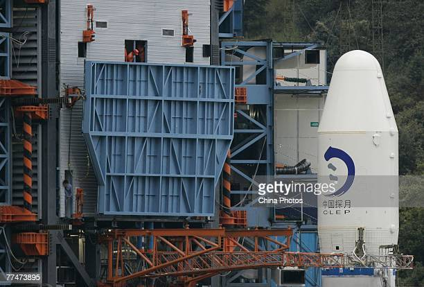 Staffs remove the cowl of Long March 3A rocket carrying China's first lunar probe Chang'e I at the Xichang Satellite Launch Center on October 24 2007...