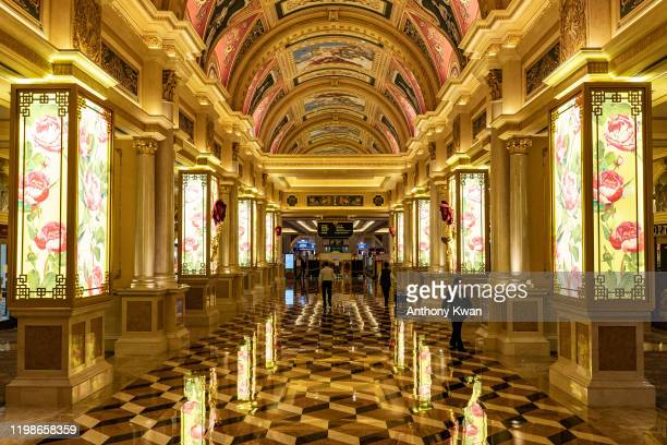 Staffs walk in hallway of The Venetian Macau after the closing of its casino on February 5, 2020 in Macau, China. Macau government announced to close...