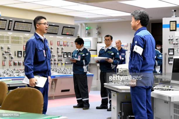 Staffs work at Kansai Electric Power Co's Oi Nuclear Power Plant on March 14 2018 in Oi Japan The No 3 reactor of the plant is restarted