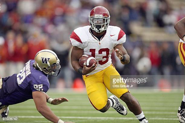 Stafon Johnson of the USC Trojans carries the ball during the game against the Washington Huskies on September 19, 2009 at Husky Stadium in Seattle,...