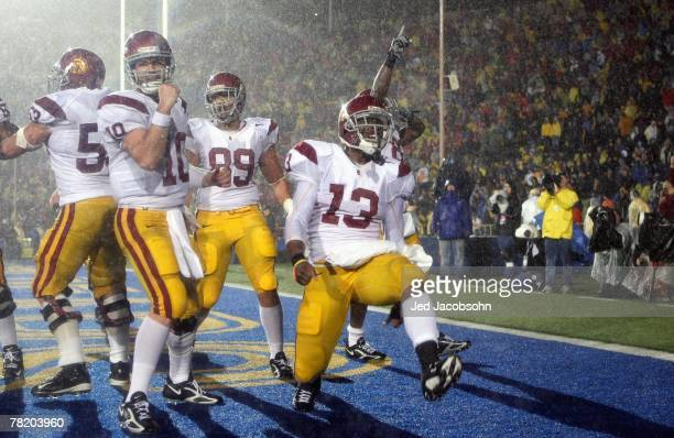 Stafon Johnson of the USC Trojans celebrates with John David Booty after scoring the winning touchdown in the fourth quarter against the California...