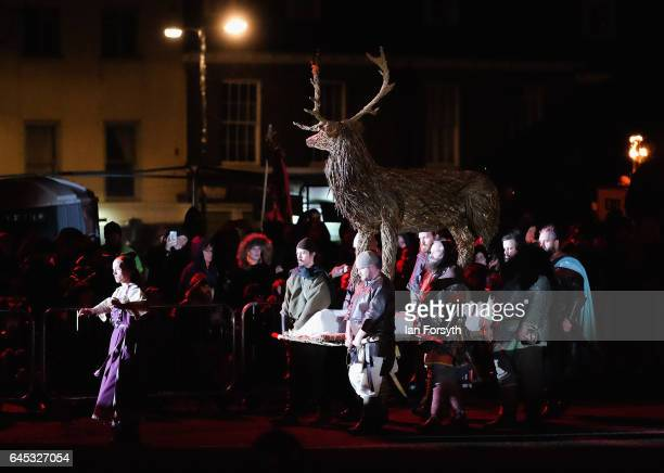 Stag is carried across the battlefield as Viking re-enactors battle during the finale of a living history display on February 25, 2017 in York,...