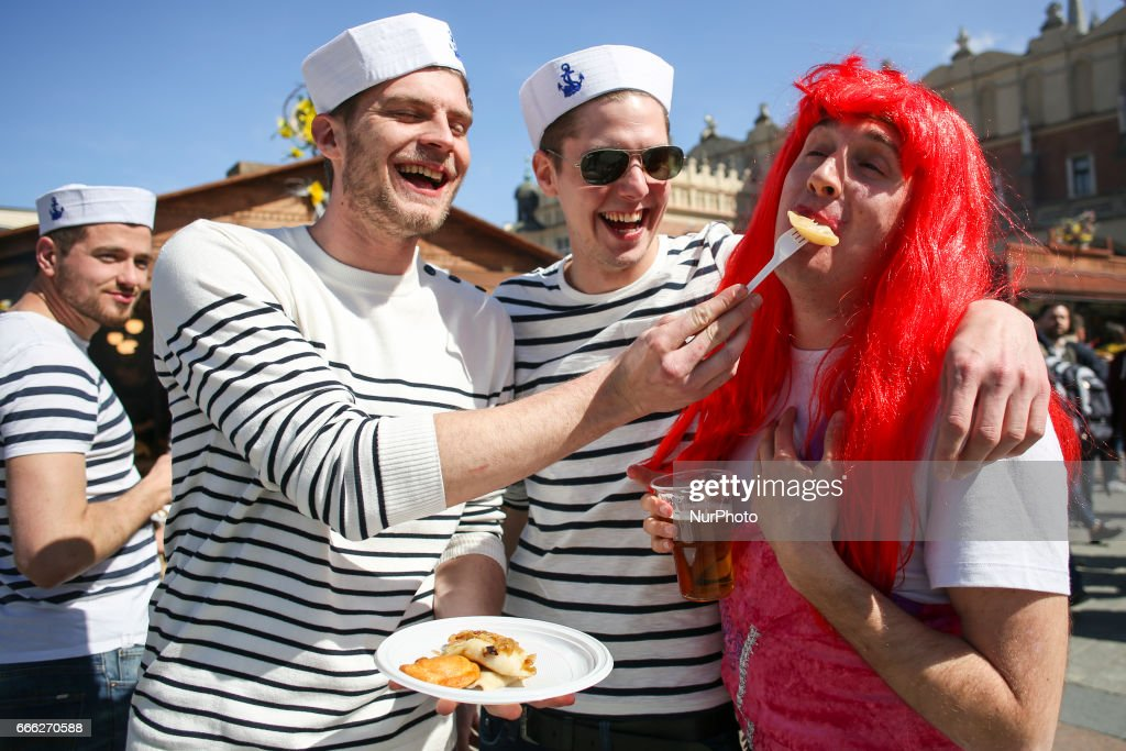 Stag tourists eating 'pierogi' at traditional Easter Market at the Main Square in Krakow, Poland on 8 April, 2017.
