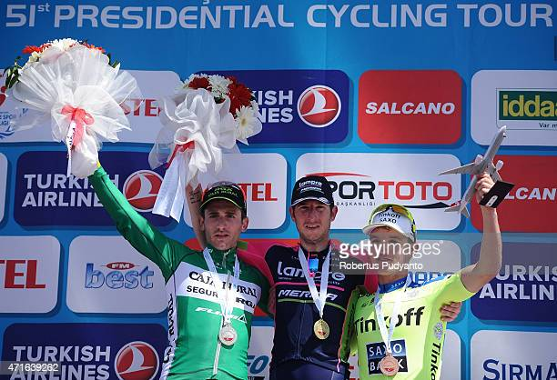 Stage 5 winners Carlos Barbero Cuesta of Caja RuralSeguros RGA Sacha Modolo of Lampre Merida and Jay McCarthy of Tinkoff Saxo celebrate on the podium...