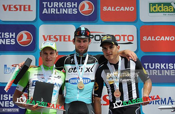 Stage 7 winners Andrea Piechele of Bardiani CSF Mark Cavendish of Etixx Quick Step and Kristian Sbaragli of MTN Qhubeka celebrate on the podium...