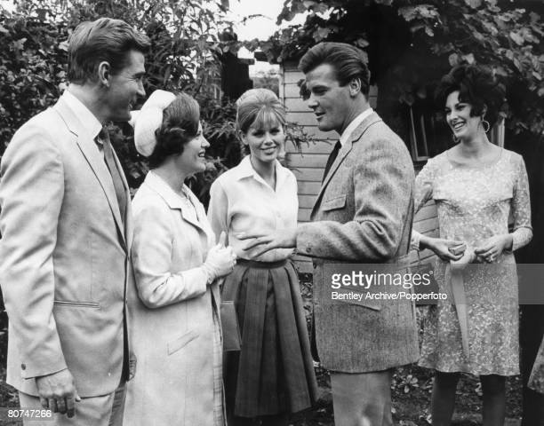 Stage and Screen Elstree Studios London England July 1966 Princess Muna alHussein of Jordan talks with film and movie actor Roger Moore during a...