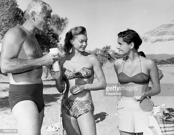Stage and Screen Italy American film and movie actor Jeff Chandler seen here with Actress Esther Williams and Rossana Podesta during a rest from...