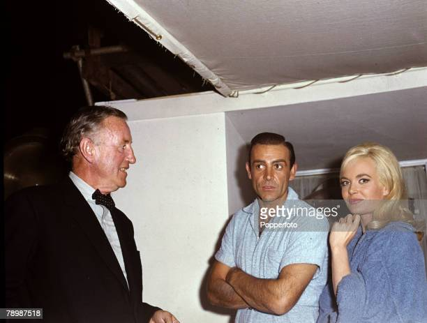 Stage and Screen Literature Personalities pic 1964 Pictured on the set of the James Bond movie 'Goldfinger' are leftright author Ian Fleming actor...
