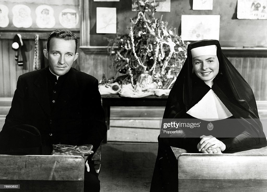 "Stage and Screen. Music / Personalities. pic: circa 1945. Bing Crosby appearing in the film "" The Bells of St. Mary"" with Swedish actress Ingrid Bergman. American singer Bing Crosby (1904-1977) actor and singer, famous for his ""crooning"" style, his hit be : News Photo"