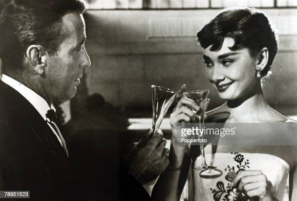 1954 Actress Audrey Hepburn ina scene from 'Sabrina Fair' with American actor Humphrey Bogart Audrey Hepburn born in Brussels a truly international...