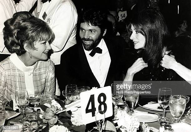 20th February 1967 American film actress Anne Baxter 19231985 left pictured with Pierre Baruch and his wife Anouk Aimee who had both won awards at...