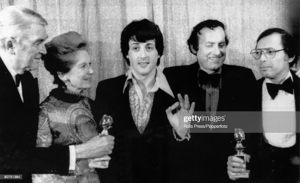 "Stage and Screen Personalities. pic: 30th January 1977. Hollywood, U.S.A. James Stewart, left accompanied by Mrs. Stewart presents the Golden Globe awards ""Best Motion Picture Drama"" to the star and writer of ""Rocky"" Sylvester Stallone, centre and Produc : News Photo"