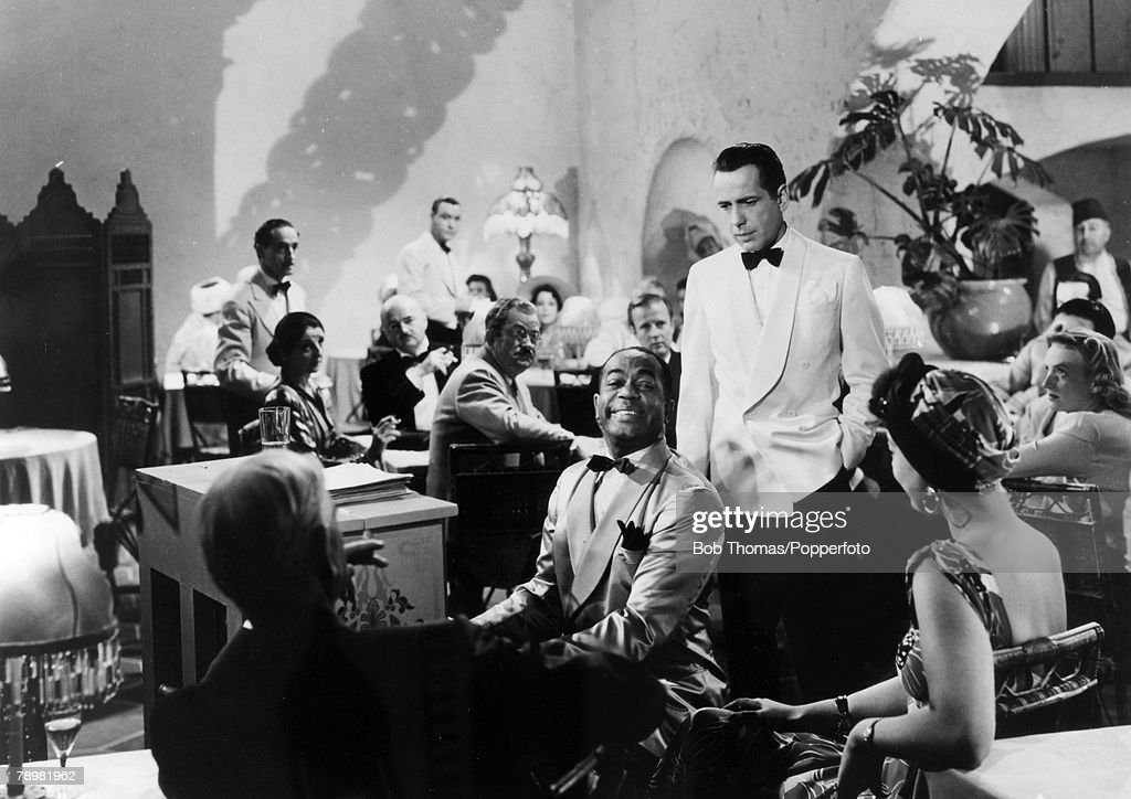 circa 1942, A scene from the film 'Casablanca' with the star Humphrey Bogart, and 'Sam' the piano player played by Dooley Wilson