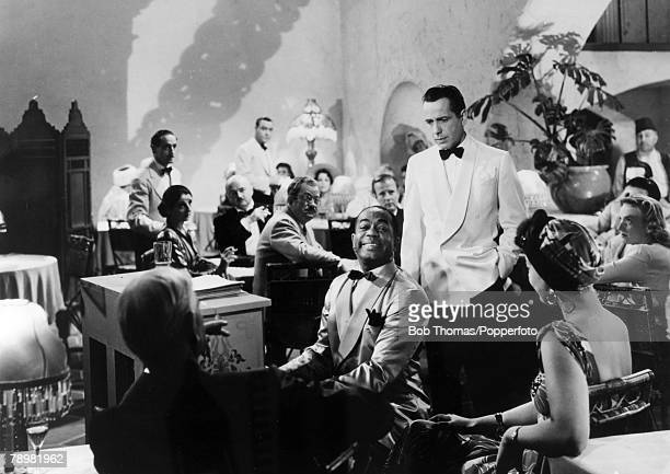 circa 1942 A scene from the film 'Casablanca' with the star Humphrey Bogart and 'Sam' the piano player played by Dooley Wilson
