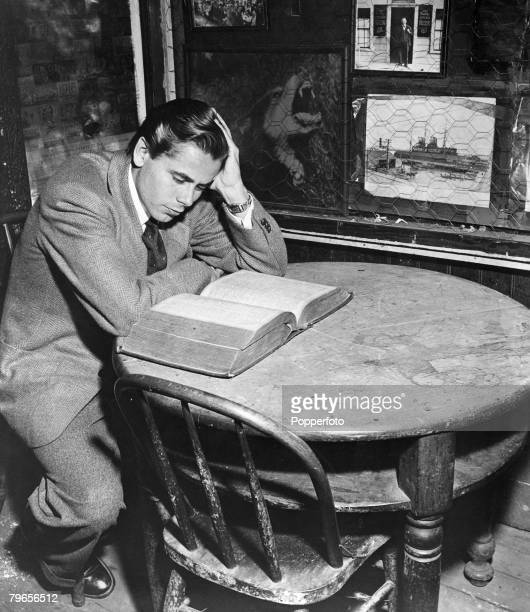 circa 1942 American actor Glenn Ford who played the title role in the fim Adventures of Martin Eden pictured inside the First and Last Chance Saloon...
