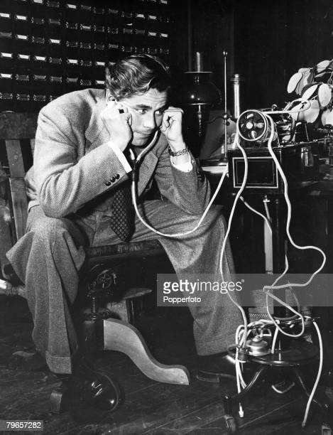 circa 1942 American actor Glenn Ford who played the title role in the fim Adventures of Martin Eden pictured listening to to the voice of the famous...