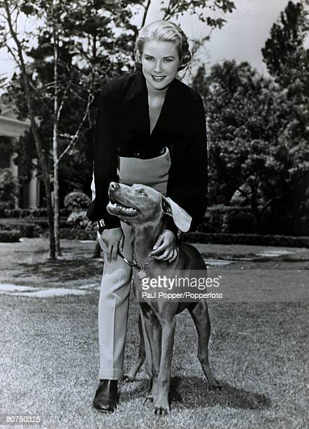 January 1956 American actress Grace Kelly pictured with her dog Grace Kelly born in Philadelphia was a cool elegant beauty who starred in such films...