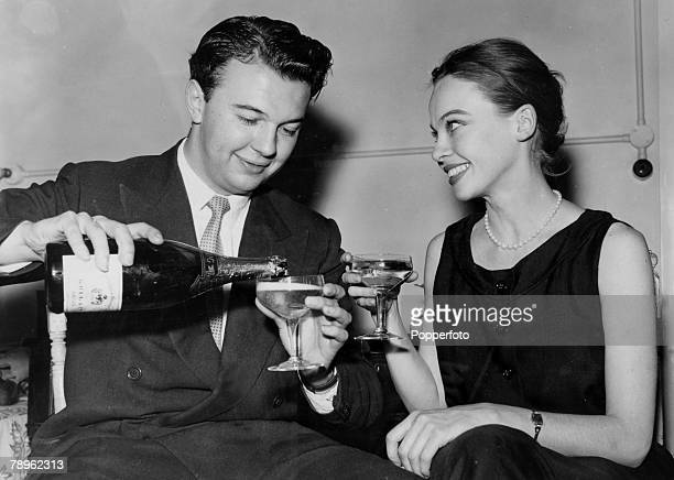 July 1956 English theatre opera and film director Peter Hall pictured with French actress Leslie Caron at the time they announced their engagement as...