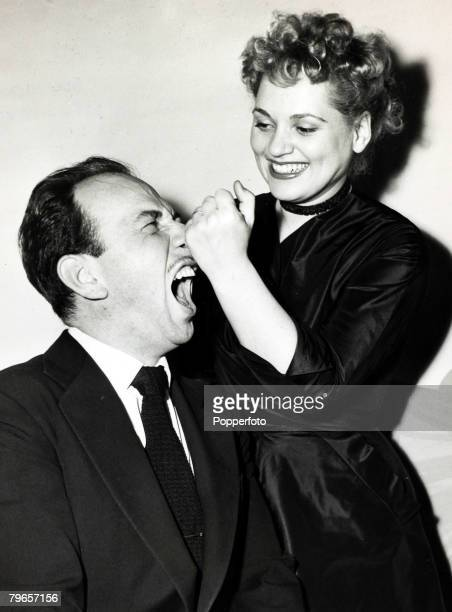March 1951 Hollywood American actress Judy Holliday the Oscar winner for Best Actress 1950 playfully pulls the nose of Oscar winning Best Actor for...