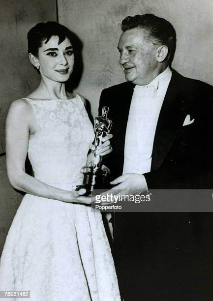 March 1954 Actress Audrey Hepburn receives her Oscar as Best Actress for her part in the film 'Roman Holiday' from actor Jean Hersholt Audrey Hepburn...