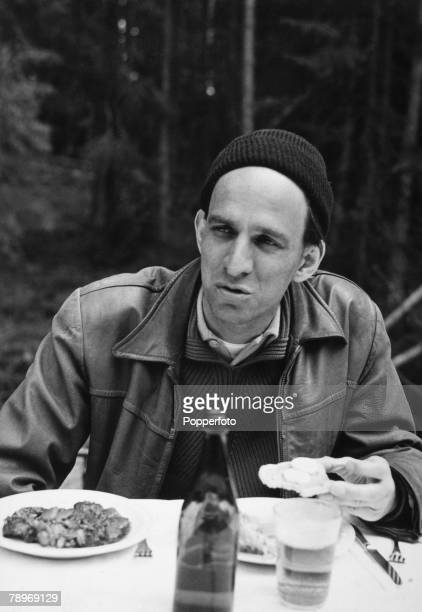 Stage and Screen Sweden Circa 1950's Swedish Film and movie director Ingmar Bergman sitting at a table eating during a break from filming The Maiden...