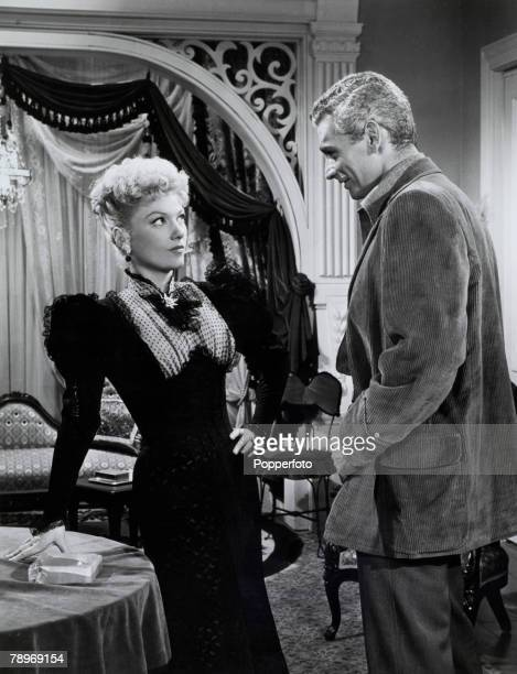 Stage and Screen, USA American actor Jeff Chandler with actress Anne Baxter from a scene from the film The Spoilers