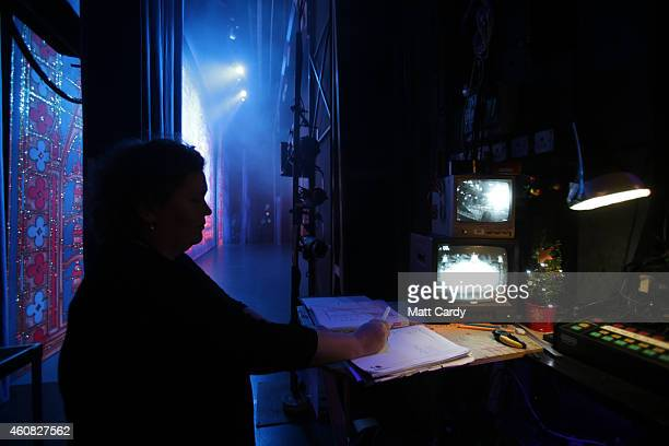 A stage assistant prepares for the start of The Bristol Hippodrome's production of Dick Whittington on December 23 2014 in Bristol England Many...