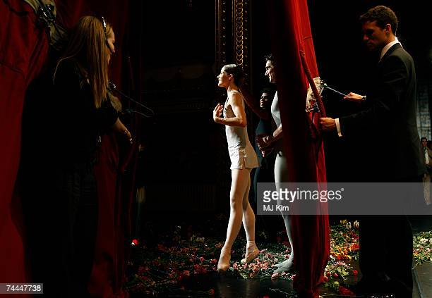 Stage crew look on as Darcy Bussell takes her final curtain call for her last performance 'Song of the Earth' at the Royal Opera House on June 8 2007...