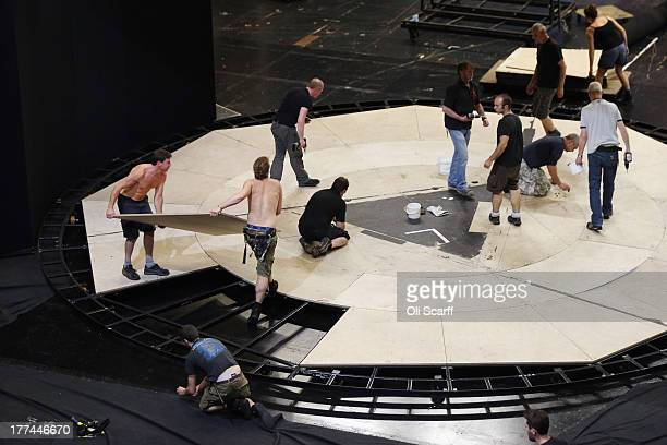 Stage crew prepare the set in Glyndebourne opera house for a production of the Benjamin Britten opera 'Billy Budd' on August 22 21013 in Lewes...