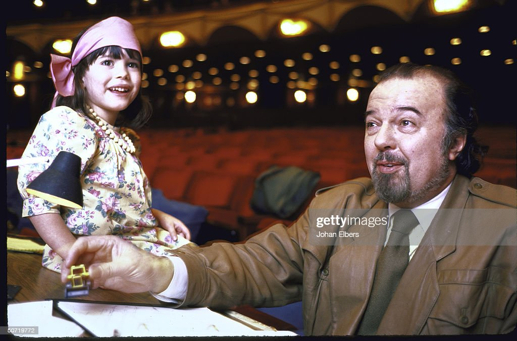 Stage dir. Sir Peter Hall w. his young daughter, while directing a new production of Verdi's Macbeth at the Metropolitan Opera.