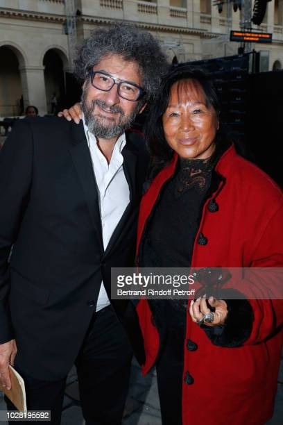 Stage director of the event Radu Mihaileanu and Mei Chen Chalais attend the Carmen Opera en Plein Air performance at Les Invalides on September 6...
