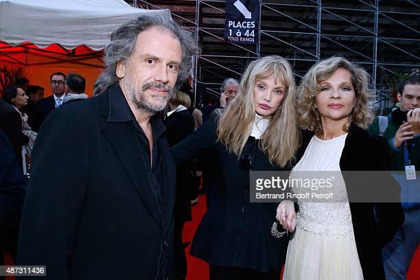 Stage Director of the Opera Arielle Dombasle standing between Eva Ionesco and her husband Journalist Simon Liberati attend 'La Traviata' Opera en...