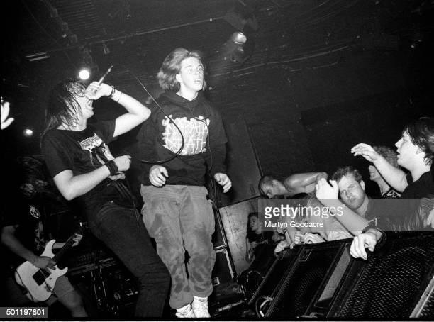 Stage invader joins the band on stage as Napalm Death perform on stage at the ICA, London, United Kingdom, 1990.