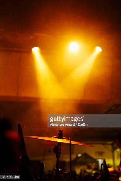 Stage Lights Falling On Cymbal During Concert