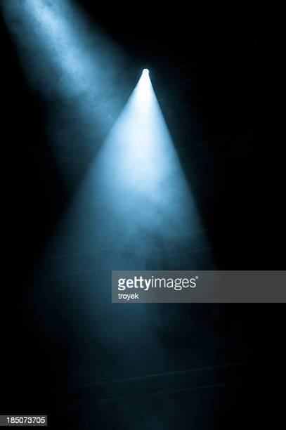 Stage Lights shining from a black background